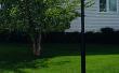 Cómo instalar un poste de luz en su yarda