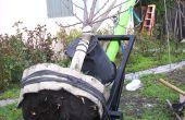 Trasplante de un árbol con un carro de ruedas dos gigantes