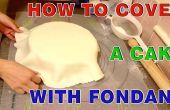 Cómo cubrir un pastel redondo con pasta de azúcar (fondant)