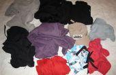 Palos la ropa para la mochila