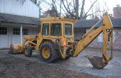 Operación de un cargador frontal John Deere / Backhoe Tractor