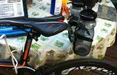 La jaula trasera para botellas para bicicleta de carretera