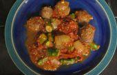 Salchicha de carne de venado con espárragos y tomates asados