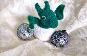 Huevos de dragón con dragón de bebé de ganchillo