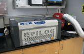 El cortador del Laser de Epilog de funcionamiento