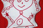 Dibujo de un niño en un peluche bordado de vuelta