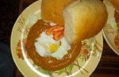 Escalfado huevo con puré de tomate picante India