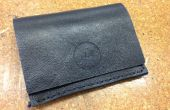 Hacer una billetera de cuero doblado simple con grabado insignia