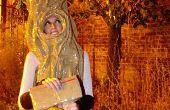 Hacer un traje de la galardonada en una noche con cinta de embalaje, periódico