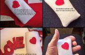 Un corazón temático calentador de la mano