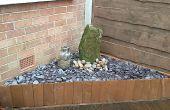 Jardín fuente de agua de roca