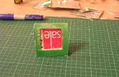 Upcycle un cartón de jugo en un marco de fotos.