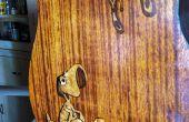 """""""Estilo de dibujos animados"""" embutido en una guitarra acústica"""