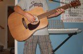 Cómo adjuntar una correa de guitarra rápidos y baratos