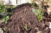 Cómo hacer un jardín de flores levantado de una pila de hormigón viejo y rocas