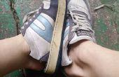 Por ciclo de zapatos viejos en zapatillas o zapatos del jardín