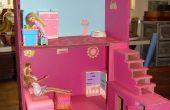 Casa de muñecas con cajas y cartón