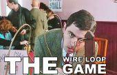 La mano juego de coordinación ojo - juego del lazo del alambre