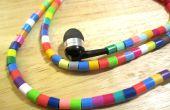 Los auriculares de un arco iris de color Me