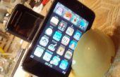 Un doble cargador de Ipod y teléfono móvil base