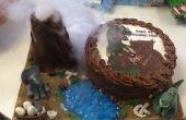 Comestibles en erupción volcán escena y pastel de dinosaurio