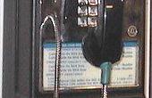 Conversión de un teléfono público para uso doméstico.