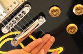Reemplazar una cadena en una guitarra de