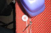 Cómo quitar el tapón de una botella de limpiador Swiffer Wet-Jet.