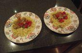 Cerdo picante y tomates con Pasta cremosa