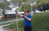 Niño amable arco y flecha