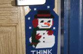 Muñeco de nieve colgador de puerta