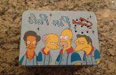 """Caja de almuerzo que juega extractos de """"Los Simpson"""""""