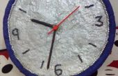 Reloj de pared de papel mache