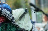 Con seguridad coger, mover y soltar Butteflies y polillas.