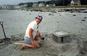 Construir un castillo de arena con su papá