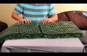 Aplicación de Mat de seto Artificial para una valla de madera