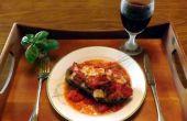 Berenjenas rellenas de queso GRUYERE, champiñones, pimientos y cebolla y cocido en una salsa de almejas vino rojo