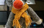 Mono de calcetín de francés (se sabe porque tiene una boina)