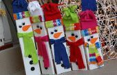 Con bisagras de madera familia muñeco de nieve