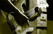 Cómo jugar 3 simples acordes en una guitarra de