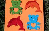 Delfines y osos de peluche de la espuma