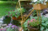 Marco de bicicleta reciclado como suspensión de planta