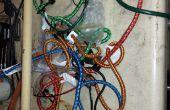 Huesuda organizador de cuerda del amortiguador auxiliar