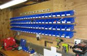 Contenedores de almacenamiento para piezas del hardware de montados en la pared fácil