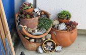 Jardín de rocas de pote de flor