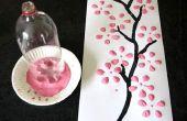 Hacer flor de la cereza con color de fondo y el agua de la botella