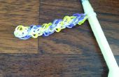Cómo hacer pulseras de telar del arco iris o los anillos utilizando el patrón de diamante triple