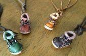 Botas de pequeño accesorio con el patrón