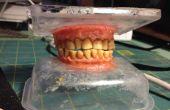 Tabaco manchados los dientes hecha de goma y maní