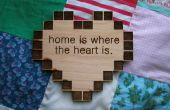 """Placa de contenedor de corazón """"hogar es donde está el corazón"""""""